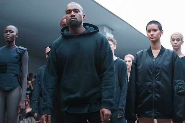 Above: Kanye showcasing his collaboration with Adidas.