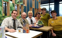 Above: McDonald's staff throw a surprise birthday party for a lonely 93-year-old widower who has gone to the restaurant almost every day since 2013