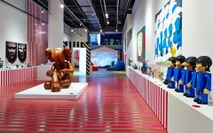 "Above: This Is Not a Toy at Canada's Design Exchange features Better Knowing, a 60"" wood sculpture by New York artist KAWS"