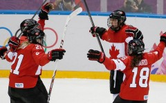 Above: Canada wins gold in women's hockey, beating USA in overtime