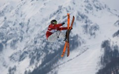 Canada's Dara Howell takes a jump during the women's freestyle skiing slopestyle at the 2014 Winter Olympics