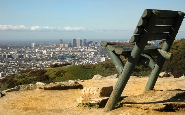Above: The wooden bench at the top of Runyon Canyon Park which overlooks Los Angeles