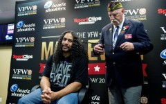 Troy Polamalu cuts one of his legendary locks to support veterans