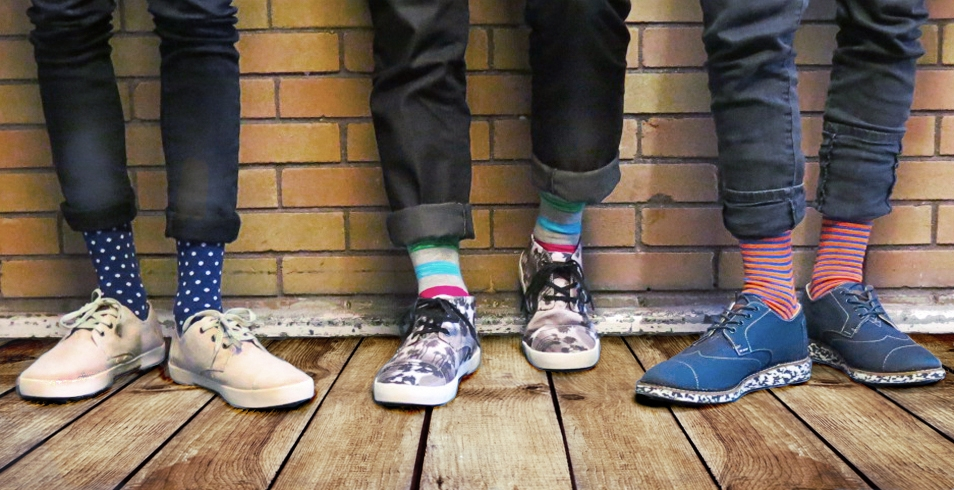 Wearing (l-r): Blue polka dot socks from Express (shown with fine burlap Paseos shoes from Toms) / Multi‑coloured striped socks from Express (shown withblack palm tree print Paseos-mid shoes from Toms) / Orange and blue stripe socks from Express (shown with navy flecked sole brogues from Toms)