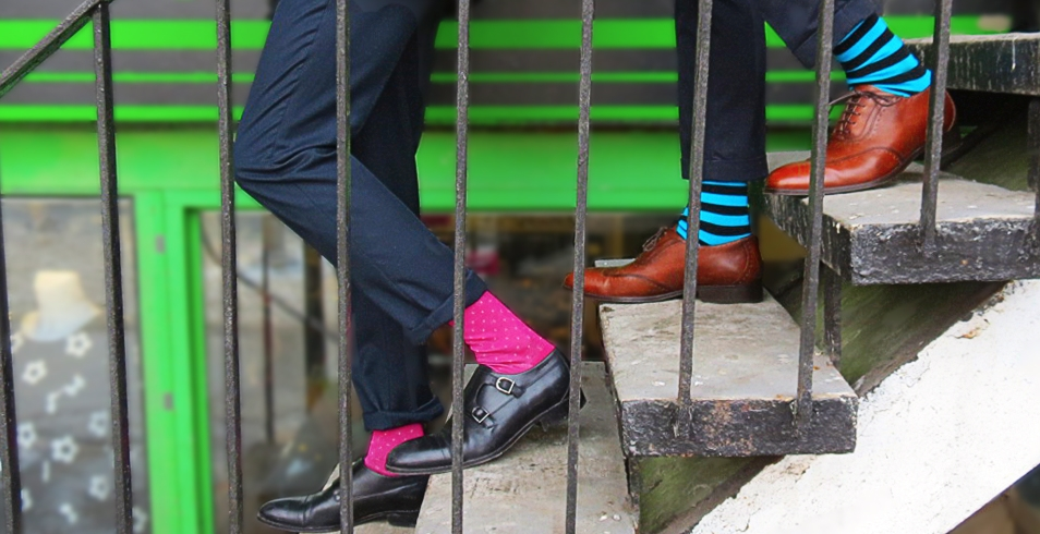 Wearing (l-r): Pink Harry & Irving socks from Socking Behaviour (shown with black double monk-straps fromEcco) / Blue stripped Corgi socks from Socking Behaviour (show with tan Dixon wing tip shoes fromEcco)