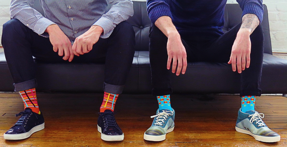 Wearing (l-r): Orange print socks from Cole + Parker (show with navy suede and patent sneakers from Lanvin) / Baby blue print socks from Cole + Parker (shown with sea print mid sneakers from Alexander McQueen for Puma)