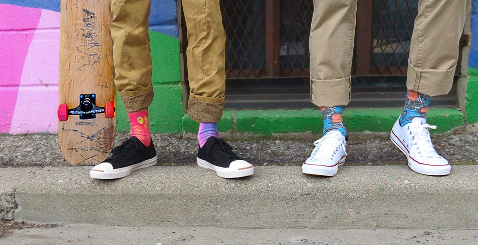 "Wearing (l-r): Coloured ""Submarine"" socks from Stance (show with black Jack Purcell sneakers from Converse) / Floral print ""Factory"" socks from Stance (show with white Chuck Taylor classic sneakers from Converse)"