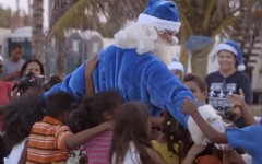 Above: WestJet's latest video takes a blue-costumed Santa to the Dominican Republic