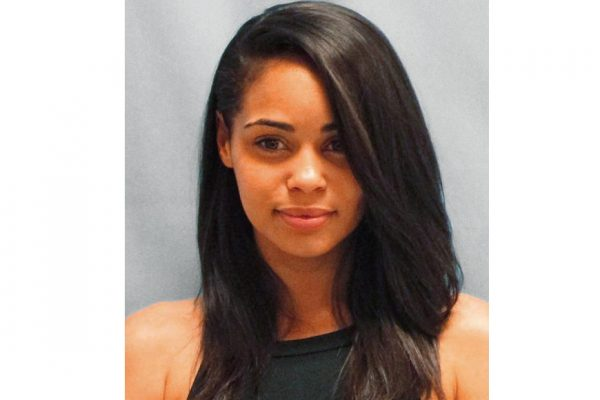 Above: A 24-year-old woman's mugshot has garnered declarations of love, marriage proposals and the nickname #PrisonBae