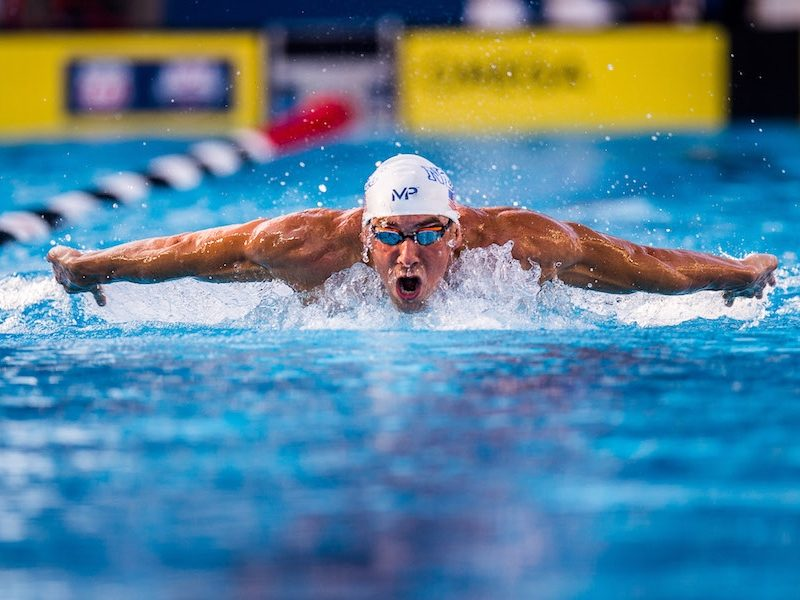 Above: Michael Phelps competes in the 200 meter butterfly