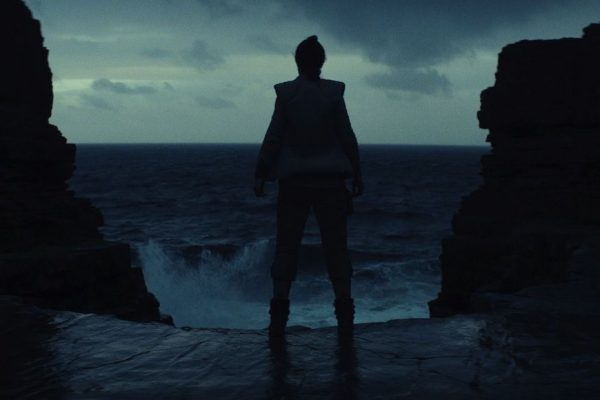 Above: A shadowy Rey (Daisy Ridley) peers into rough waters