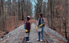 Above: Dustin (Gaten Matarazzo) and Steve (Joe Keery) patrol the forest