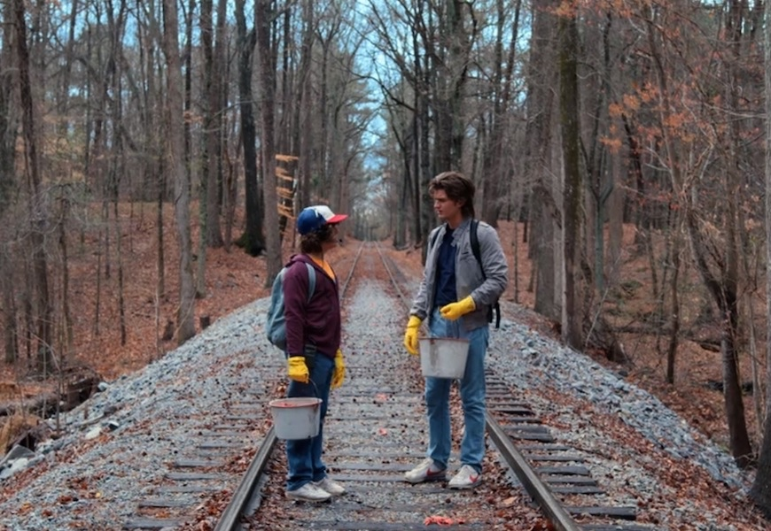 Above: Dustin (Gaten Matarazzo) and Steve (Joe Keery) patrol the forest