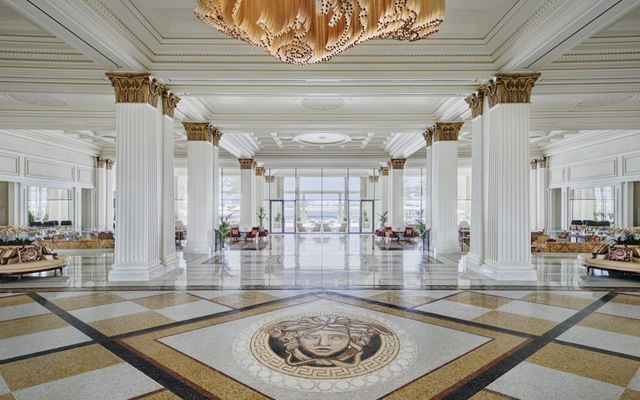 Above: The grand lobby and the extraordinary marble mosaic at the Palazzo Versace
