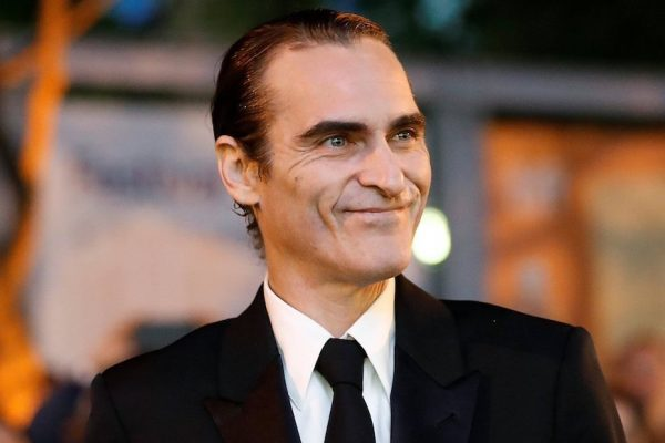 Above: Joaquin Phoenix appears on the red carpet