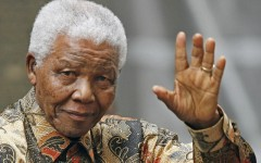 Above: Former South African President Nelson Mandela waves as he arrives in central London, England. August 28, 2007