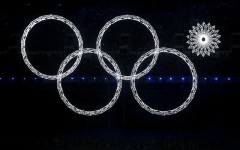 Above: One of the Olympic rings malfunctions during Sochi's Opening Ceremony