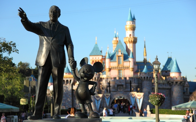 """Above: The bronze """"Partners"""" statue of Walt Disney and Mickey Mouse near the entrance of the Sleeping Beauty Castle in Disneyland"""
