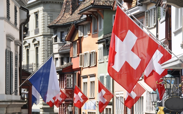 Above: An old street in Zurich decorated with flags for the Swiss National (Photo credit: Alexander Chaikin/Shutterstock)