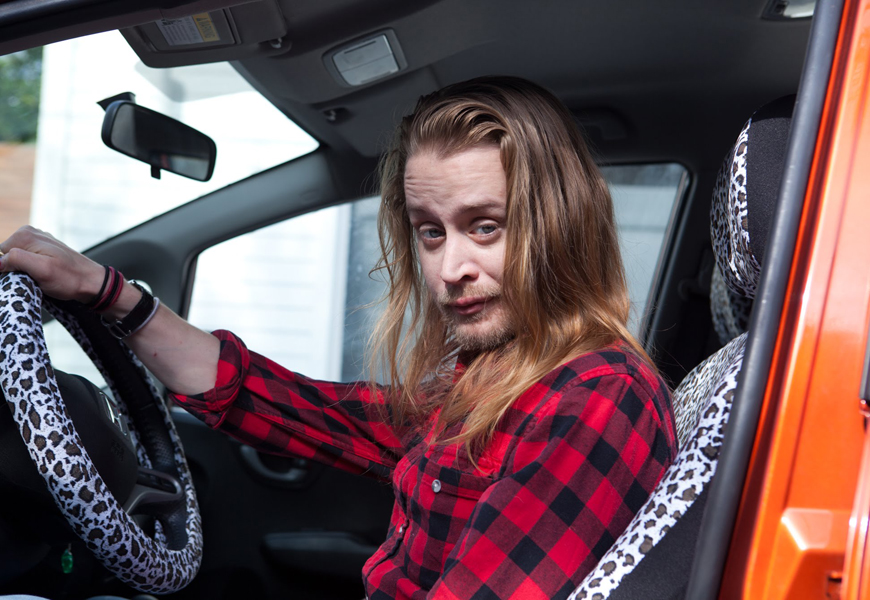 Above: Macaulay Culkin reprises his 'Home Alone' character Kevin McCallister in ':DRYVRS' premiere episode