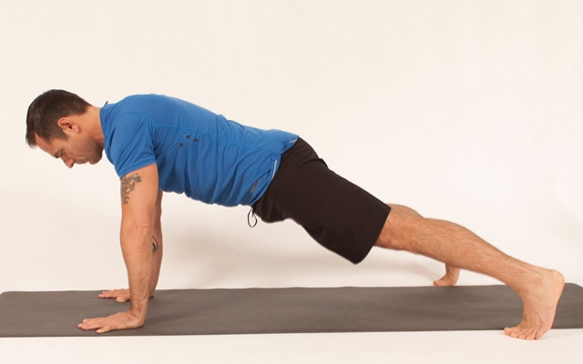 Above: Michael DeCorte demonstrates a high plank (Photo credits: Glenn Gebhardt)