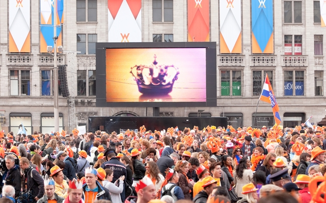 Above: Thousands gather in Dam Square after the royal inauguration and speech of King Willem-Alexander, April 30, 2013, Amsterdam, The Netherlands (Photo credit: Gertan/Shutterstock)