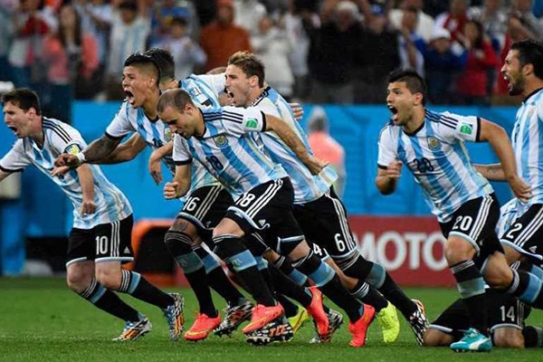 Argentina charge the field after their penalty shootout against the Netherlands