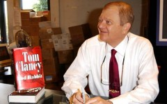 Above: Tom Clancy at a 2002 book signing for his bestselling novel, Red Rabbit
