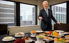 Bill Clinton shows off an all-veggie lunch spread (Photo: Ben Baker/AARP The Magazine)