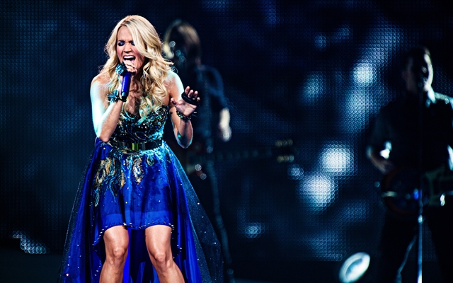 Carrie Underwood performs on stage in Seattle, WA for her Blown Away tour on October 6, 2012 (Photo credit: Mat Hayward/Shutterstock)