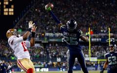 Above: Richard Sherman makes the game-winning interception last Sunday