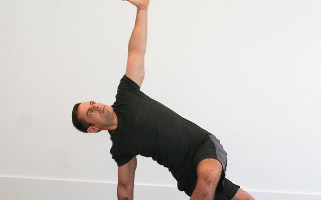 Jock Yoga Tutorial: Core-Strengthening And Rotation With Hip-Opener (Photo credits: Glenn Gebhardt)