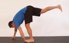 Above: Michael DeCorte demonstrates balancing with a leg and wrist stretch (Photo credits: Glenn Gebhardt)