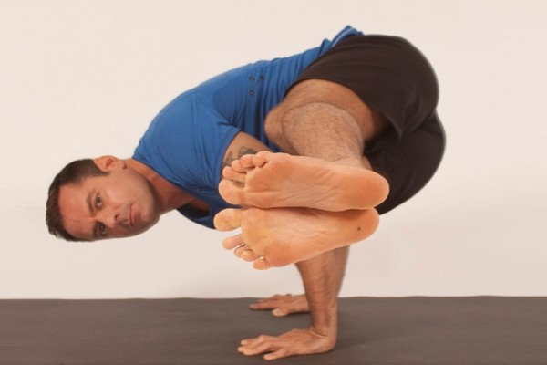Learn how to perform a spinal twist to arm balance yoga pose (Photo credits: Glenn Gebhardt)