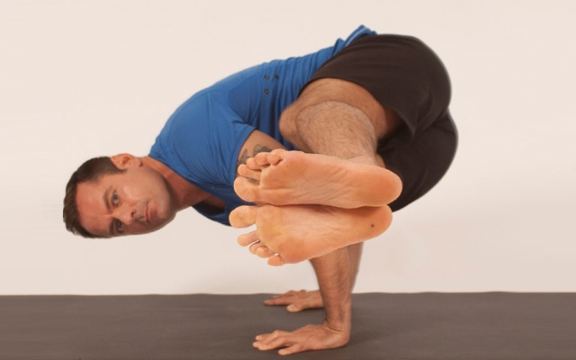 Learn how to perform a spinal twist to arm balance yoga pose (Photo credits: Glenn Gebhardt)