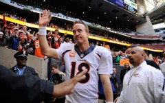 Above: The Broncos' Peyton Manning after he set an NFL record with his 51st touchdown pass