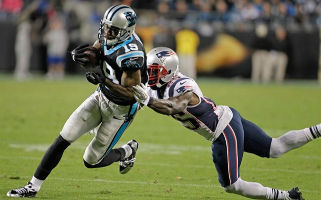 Carolina Panthers' Ted Ginn (19) runs past New England Patriots' Kyle Arrington (25) for a touchdown during the second half of an NFL football game in Charlotte, N.C., Monday, Nov. 18, 2013. The Panthers won 24-20