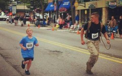 Boden Fuchs and Myles Kerr running the 5K race (Photo: Facebook)