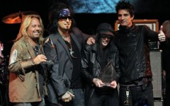 Above: Vince Neil, Nikki Sixx, Mick Mars and Tommy Lee pose together onstage at a tribute to the band in West Hollywood, California