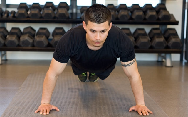Learn how to perform a Wide Push-Up (Photos by: Timothy Flynn - Dearhunter Photography)