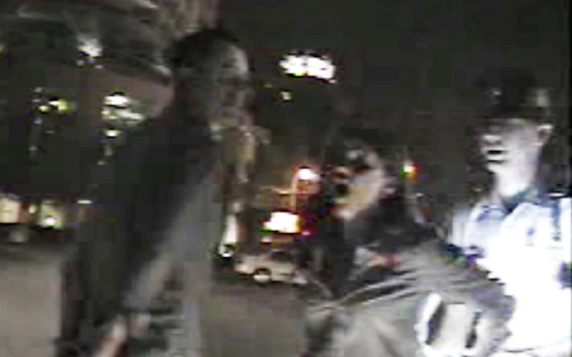 Above: A screencap of the dash-cam video of Reese Witherspoon's arrest released by law enforcement
