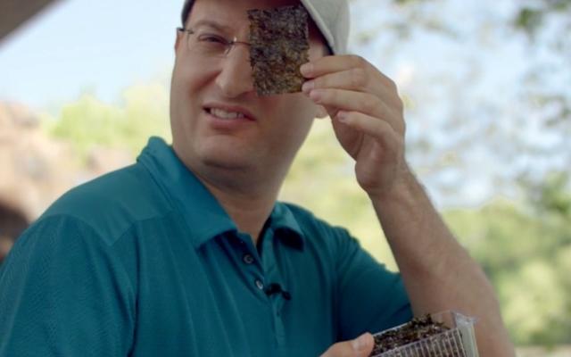 Above: Mike Dojc reviews golf snacks
