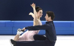 Above: Tessa Virtue and Scott Moir win silver for ice dance at Sochi on Monday