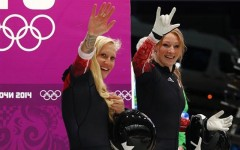 Canadians Kaillie Humphries and Heather Moyse made Olympic history by becoming the first women bobsledders to repeat as Olympic champions on Wednesday