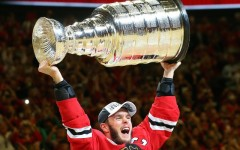 Above: Blackhawks captain Jonathan Toews celebrates by hoisting the Stanley Cup after defeating the Tampa Bay Lightning