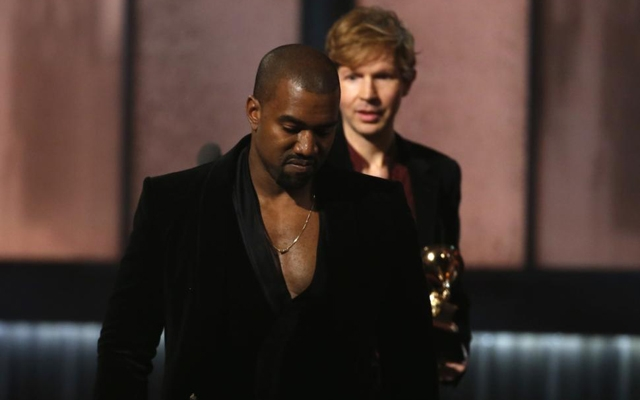 Above: Kanye West stole the spotlight at the Grammys once again by rushing to the stage when Beck won the Album of the Year award for his 'Morning Phases'