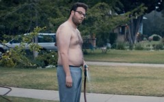Above: Seth Rogen shows off his dadbod in 'Neighbors'
