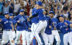 Above: The Toronto Blue Jays celebrate after beating the Texas Rangers 6-3 in Game 5 of the American League Division Series in Toronto