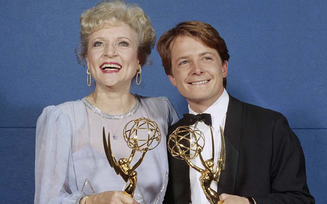 Above: Betty White and Michael J. Fox pose with their Emmy Awards for Outstanding Lead Actress and Actor in a Comedy Series in 1986. White won for her role on the Golden Girls and Fox for his on Family Ties