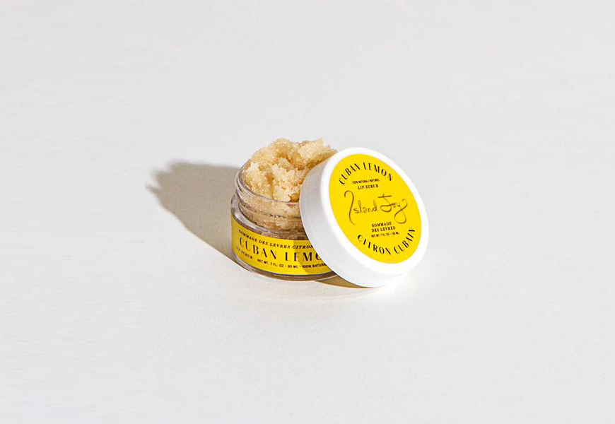 This month? Your must-have product is Island Joy's Cuban Lemon Lip Scrub
